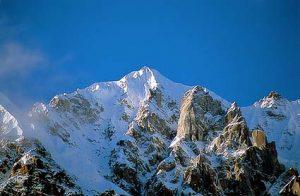 photo of snow capped Mt. Hkakabo Razi with blue sky